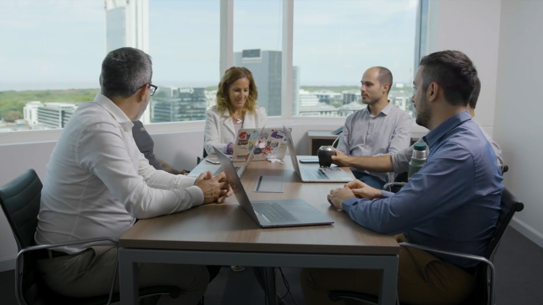 coworkers meeting around table