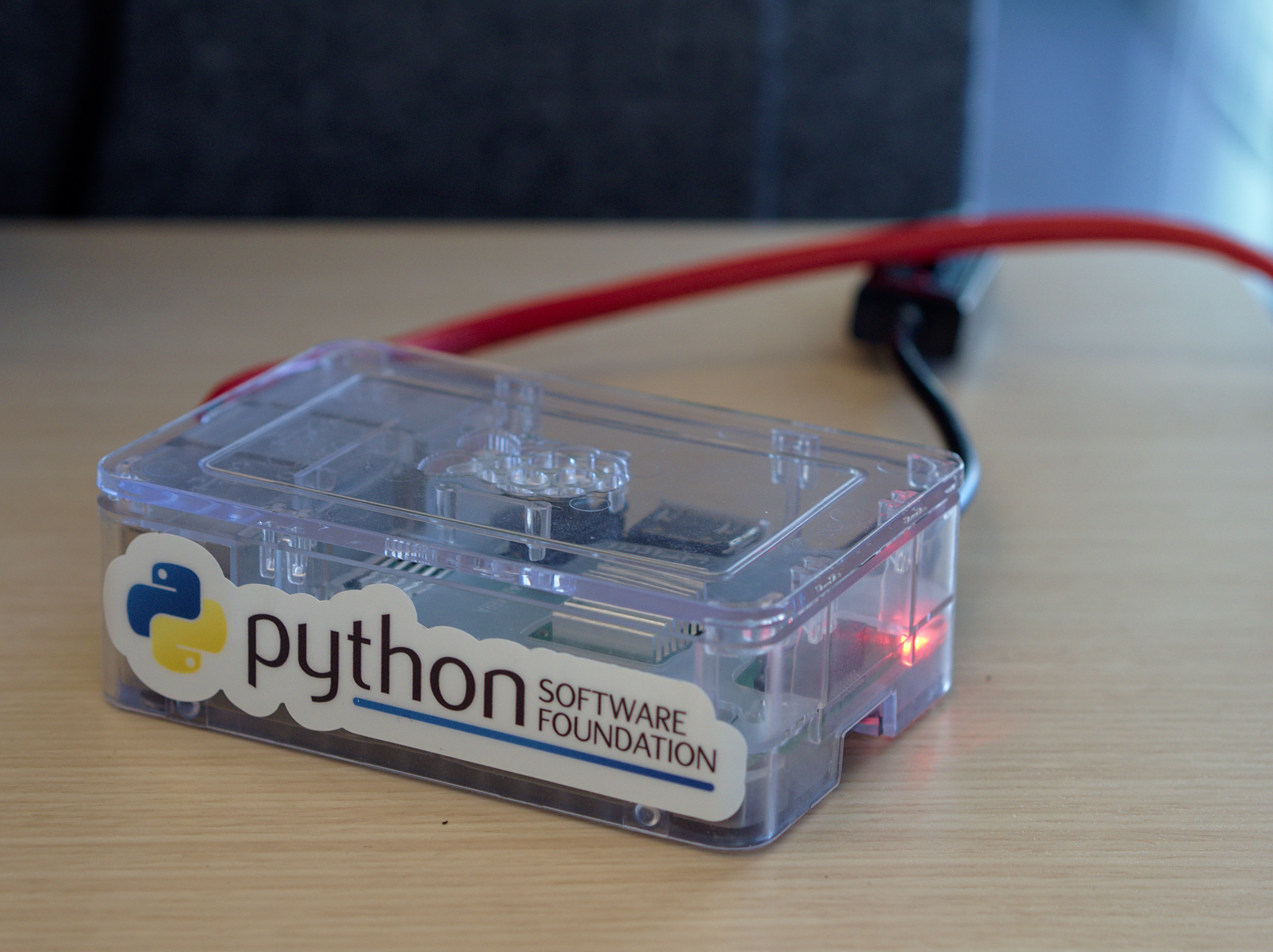 A raspberry pi case plugged into the network