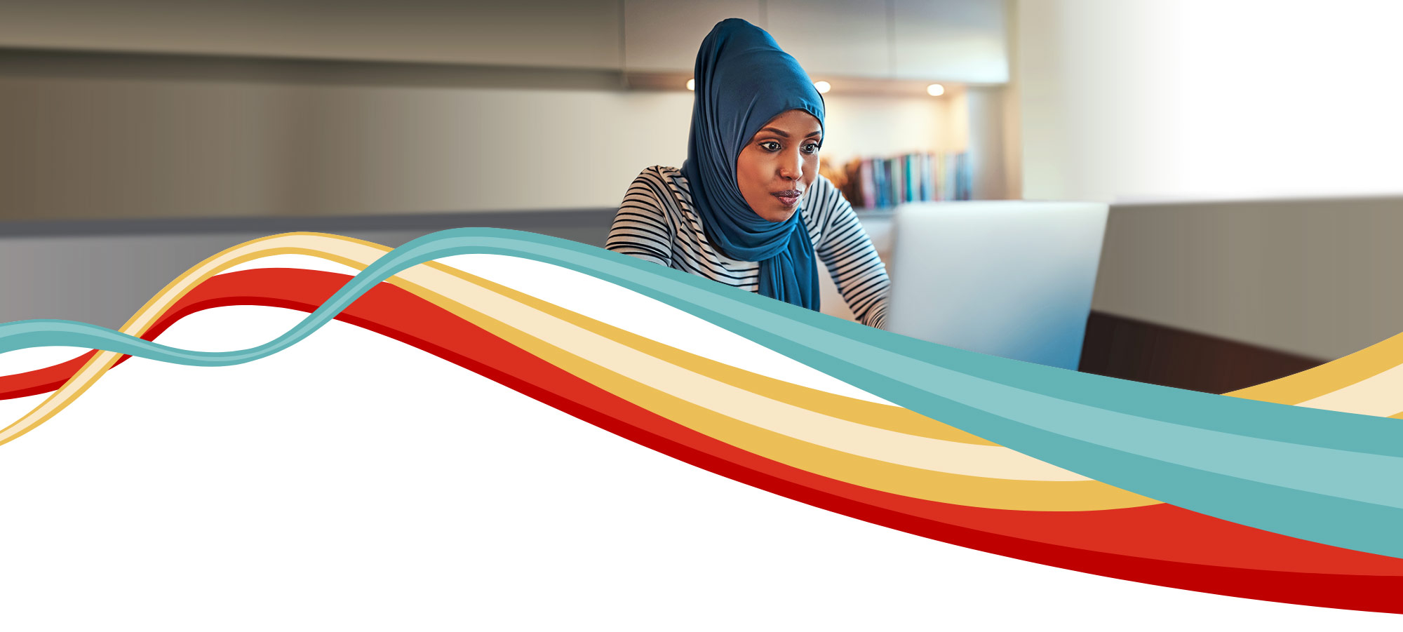 woman working on laptop with ribbon graphic