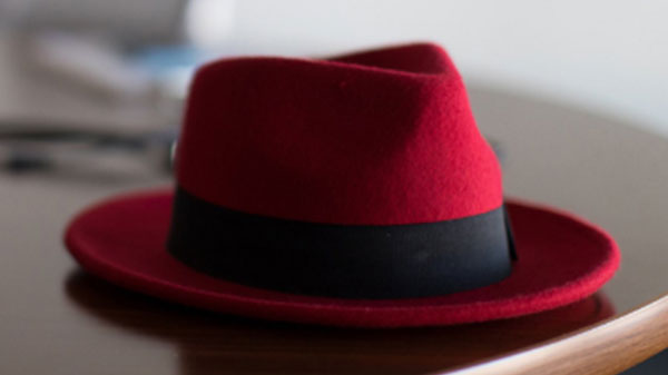 A red hat laying on a desk