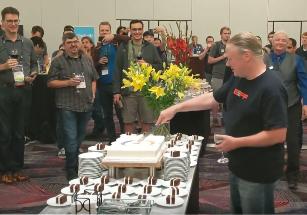 ASF Founder Brian Behlendorf cuts the ceremonial 20-year birthday cake at this year