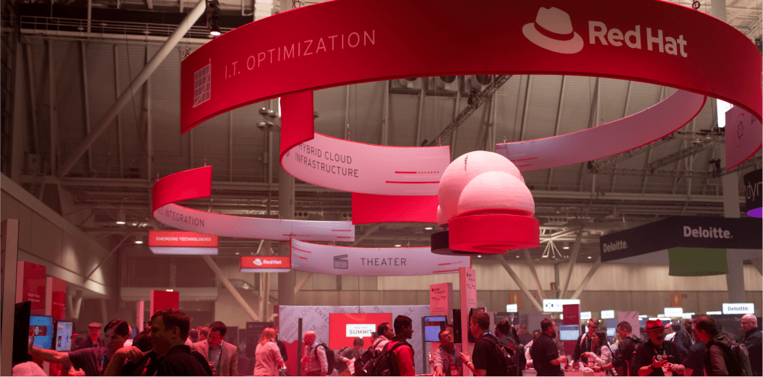 Red Hat Summit event booths and attendees