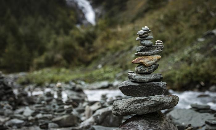 stone tower balanced by river